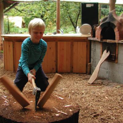 boy-chopping-wood-kitchen